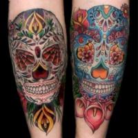 Amasing sugar skulls tattoo on arm