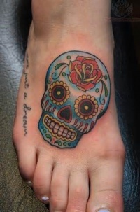 Blue sugar skull with rose foot tattoo