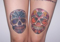 Coloured sugar skull tattoo on knees