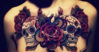 Great wonderful sugar skull and roses tattoo on chest