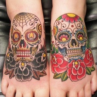 Lovely mexican sugar skulls tattoo for feet