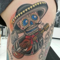 Mexican sugar skeleton plays guitar tattoo