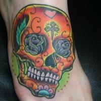 Orange sugar skull tattoo on foot